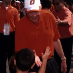 T. Boone Pickens greets a young OSU fan during 2003 opening ceremonies of the renovated T. Boone Pickens Stadium in Stillwater, Oklahoma.