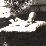 Infant Thomas T. Boone Pickens II enjoys a blanket in the yard of his family's Holdenville, Oklahoma, home.