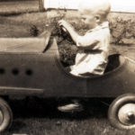 "Young T. Boone Pickens drives his ""first car"" through the family's back yard in Holdenville, Oklahoma."