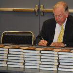 "T. Boone Pickens signs copies of ""The First Billion is the Hardest"" before accepting the L. Austin Weeks Memorial Medal from the American Association of Petroleum Geologists Foundation in Denver in June 2009. Pickens received the award in recognition of his extraordinary philanthropy and service to the foundation."