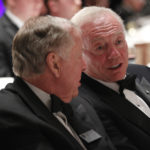 National Football Foundation board members T. Boone Pickens and Jerry Jones, owner of the Dallas Cowboys, talk during the National Football Foundation Hall of Fame dinner at the Waldorf Astoria Hotel in New York December 4, 2012.