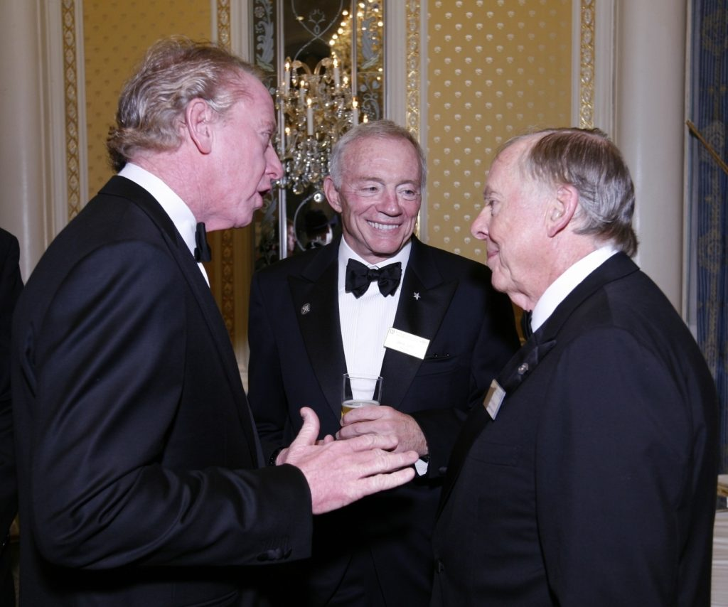 Former NFL quarterback Archie Manning, Dallas Cowboys owner Jerry Jones, and T. Boone Pickens chat at the National Football Foundation Awards ceremony in 2008. Pickens received the Distinguished American Award during the ceremony.