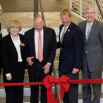 Building Strong Kids co-chairs Garrett Boone and Gail Madden, T. Boone Pickens, YMCA Metropolitan Dallas president and CEO Gordon Echtenkamp, and Dallas Mayor Tom Leppert prepare to cut the ribbon opening the newly renamed Downtown YMCA as the T. Boone Pickens YMCA in November 2009. Pickens gave $5 million to the campaign, the largest single gift in the organization's history.