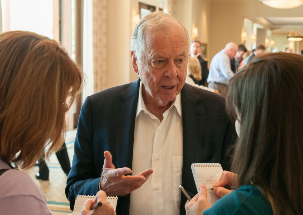 T. Boone Pickens answers media questions after appearing on an Energy Roundtable during the Western Governors' Association annual meeting in Park City, Utah, in June 2013.